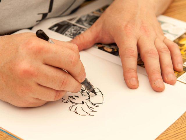 Zeichner auf dem Comic Festival, Foto: Comic Festival